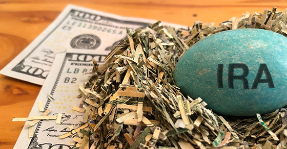 Hundred Dollar Bills with IRA Nest Egg