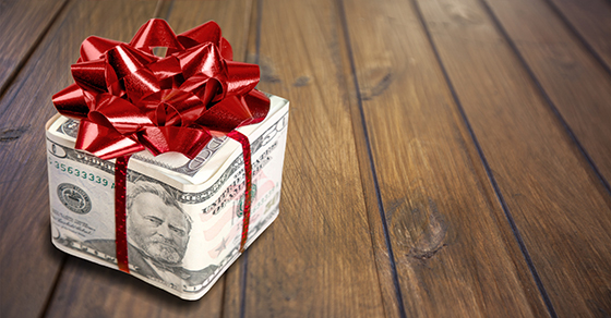 Gift box wrapped in $50 bill